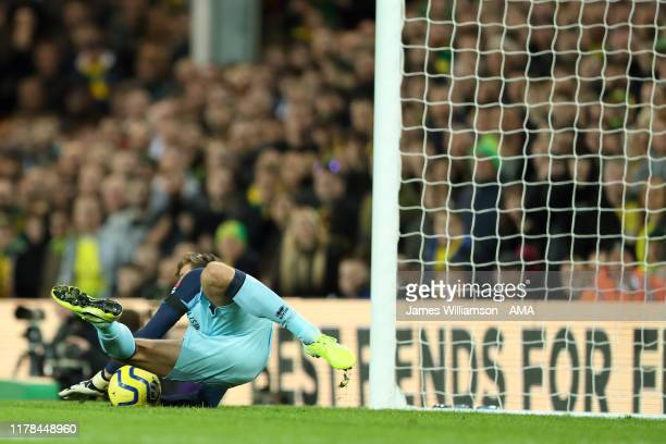 Tim Krul of Norwich City saves the penalty of Marcus Rashford of Manchester United during the Premier League match between Norwich City and...
