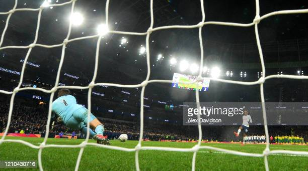 Tim Krul of Norwich City saves the penalty taken by Gedson Fernandes of Tottenham Hotspur to win the penalty shoot out during the FA Cup Fifth Round...