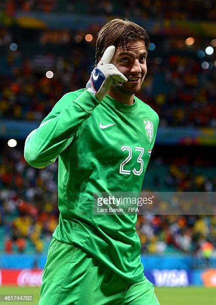 Tim Krul of the Netherlands celebrates the win after stopping two penalty kicks in a penalty shootout in the 2014 FIFA World Cup Brazil Quarter Final...