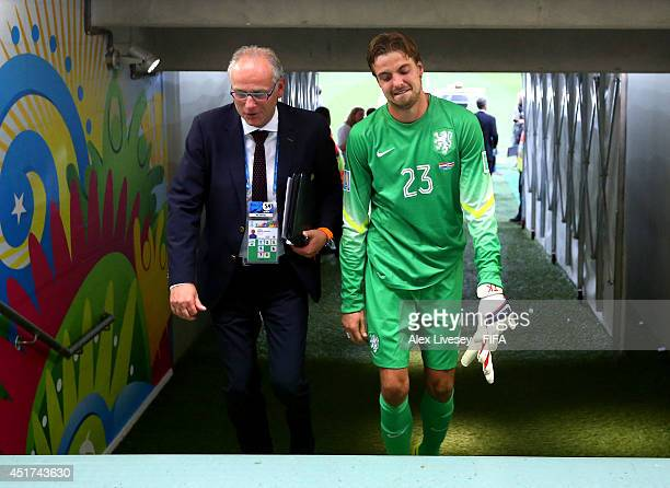 Tim Krul of the Netherlands celebrates while walking in the tunnel after the win in a penalty shootout in the 2014 FIFA World Cup Brazil Quarter...