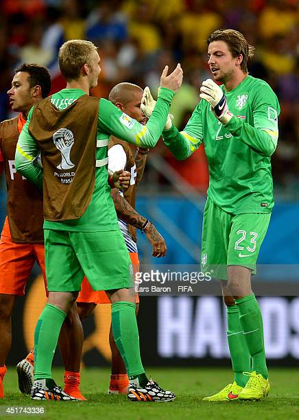 Tim Krul of the Netherlands is congratulated by Jasper Cillessen for the win in the penalty shootout after the 2014 FIFA World Cup Brazil Quarter...