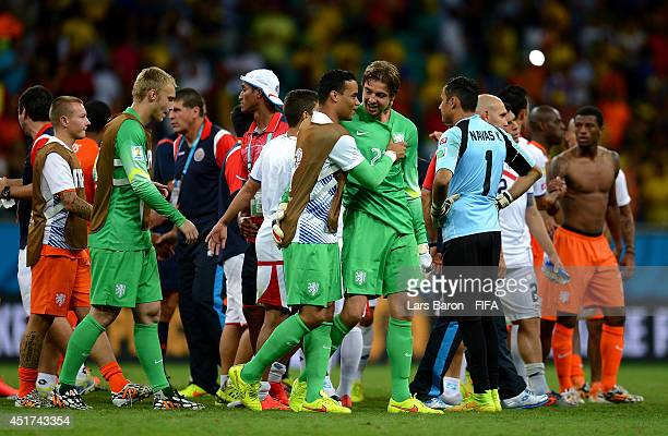 Tim Krul of the Netherlands is congratulated by Michel Vorm and Jasper Cillessen on the win in the penalty shootout after the 2014 FIFA World Cup...