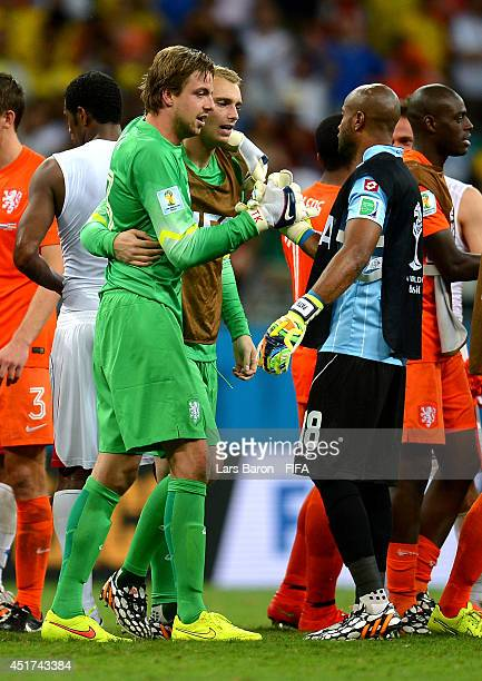 Tim Krul of the Netherlands shakes hands with Patrick Pemberton of Costa Rica after the win in the penalty shootout in the 2014 FIFA World Cup Brazil...