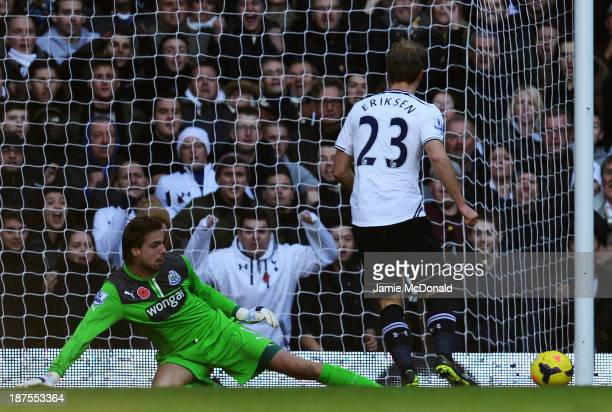Tim Krul the Newcastle United goalkeeper makes a save under pressure from Christian Eriksen of Tottenham Hotspur during the Barclays Premier League...