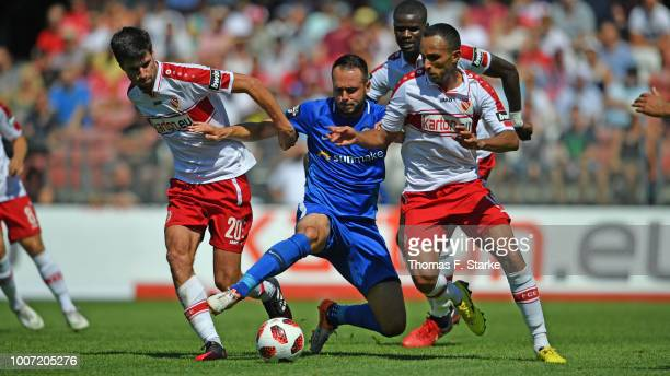 Tim Kruse and Marcelo Freitas of Cottbus tackle Pascal Breier of Rostock during the 3. Liga match between FC Energie Cottbus and F.C. Hansa Rostock...