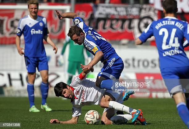 Tim Kruse of Halle is challenged by Maik Kegel of Kiel during the Third League match between Hallescher FC and Kieler SV Holstein at Erdgas Sportpark...