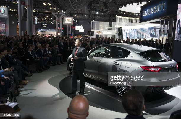 Tim Kuniskis head of Alfa Romeo for Fiat Chrysler Automobiles NV speaks while standing in front of the Maserati SpA Levante Trofeo vehicle during the...