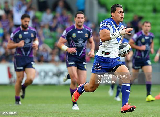Tim Lafai of the Bulldogs breaks through the Storm defence to score a try during the NRL 2nd Elimination Final match between the Melbourne Storm and...