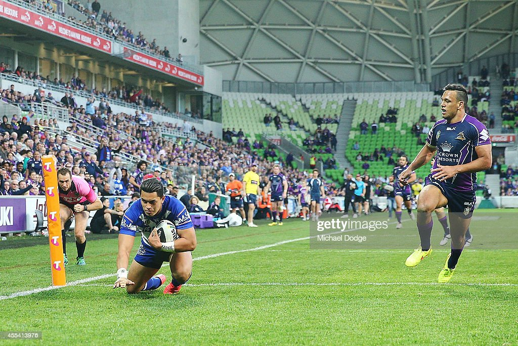 Tim Lafai of the Bulldogs scores a try next to Will Chambers of the Storm during the NRL 2nd Elimination Final match between the Melbourne Storm and the Canterbury Bankstown Bulldogs at AAMI Park on September 14, 2014 in Melbourne, Australia.