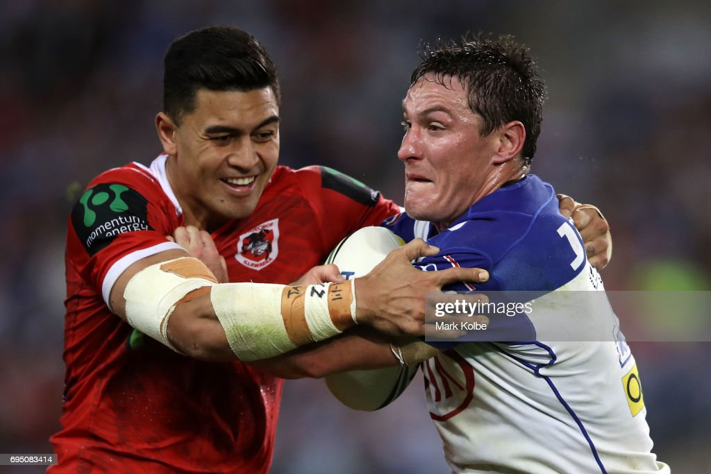 Tim Lafai of the Dragons tackles Josh Jackson of the Bulldogs during the round 14 NRL match between the Canterbury Bulldogs and the St George Illawarra Dragons at ANZ Stadium on June 12, 2017 in Sydney, Australia.