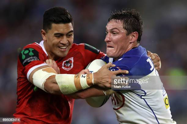 Tim Lafai of the Dragons tackles Josh Jackson of the Bulldogs during the round 14 NRL match between the Canterbury Bulldogs and the St George...