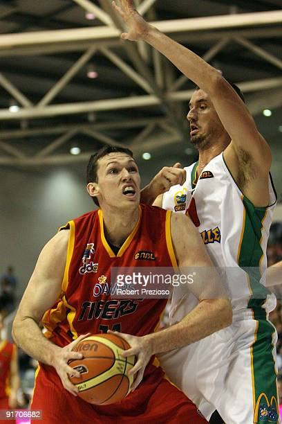 Tim Lang of the Tigers drives to the basket during the round three NBL match between the Melbourne Tigers and the Townsville Crocodiles on October...