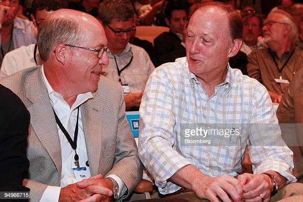 Tim Lee vice president of global manufacturing for General Motors Co left speaks with John F Smith vice president of global product planning during a...