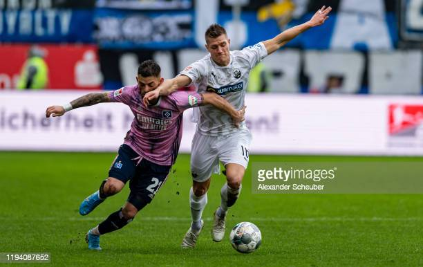 Tim Leibold of Hamburger SV in action against Kevin Behrens of Sandhausen during the Second Bundesliga match between SV Sandhausen and Hamburger SV...