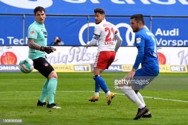 Tim Leibold of Hamburger SV scores their team's first goal past Kevin Mueller of 1. FC Heidenheim 1846 during the Second Bundesliga match between...