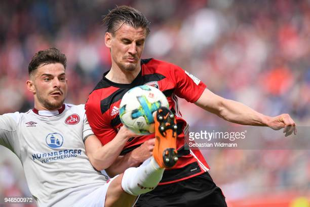 Tim Leibold of Nuernberg and Stefan Kutschke of Ingolstadt compete for the ball during the Second Bundesliga match between FC Ingolstadt 04 and 1 FC...