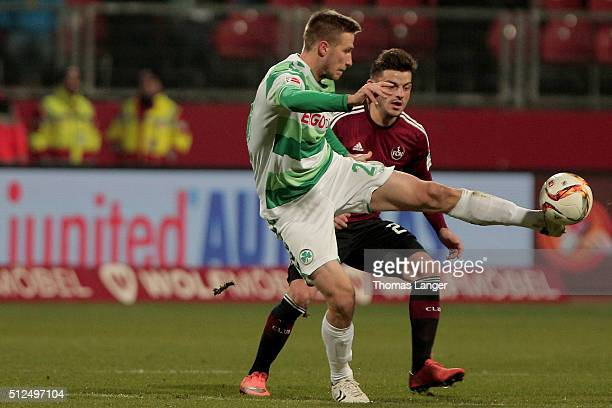 Tim Leibold of Nuernberg challenges Marco Stiepermann of Fuerth during the Second Bundesliga match between 1 FC Nuernberg and Greuther Fuerth at...