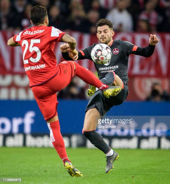 Tim Leibold of Nuernberg is challenged by Matthias Zimmermann of Fortuna Duesseldorf during the Bundesliga match between Fortuna Duesseldorf and 1 FC...