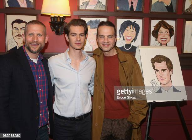 Tim Levy Andrew Garfield and Jordan Roth pose at the unveiling of Andrew Garfield's caricature honoring his performance in the play 'Angels in...