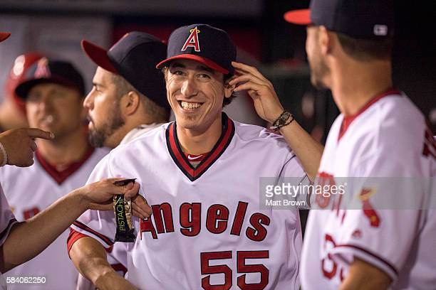 Tim Lincecum of the Los Angeles Angels of Anaheim smiles while joking around with teammates in the dugout during the game against the Chicago White...