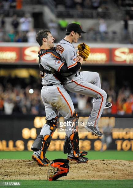 Tim Lincecum of the San Francisco Giants is lifted by Buster Posey after pitching a no hitter during a baseball game against the San Diego Padres at...