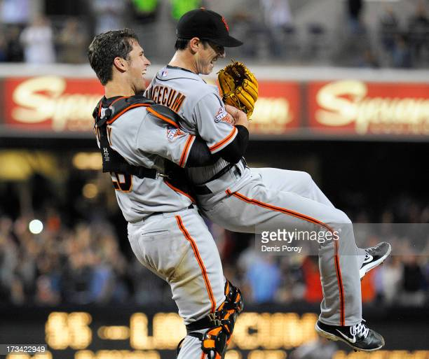 Tim Lincecum of the San Francisco Giants is lifted by Buster Posey after pitching a nohitter during a baseball game against the San Diego Padres at...
