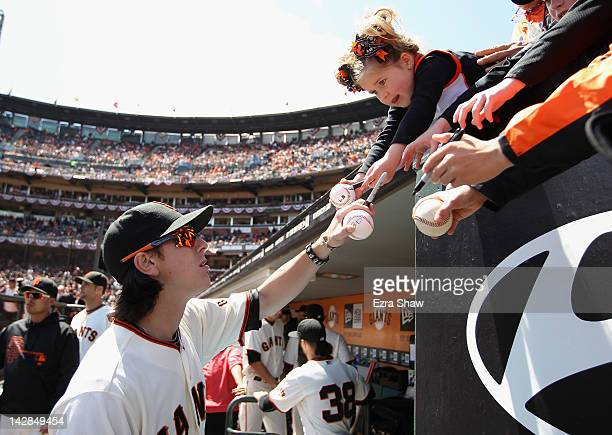 Tim Lincecum of the San Francisco Giants signs autographs before their game against the Pittsburgh Pirates at ATT Park on April 13 2012 in San...