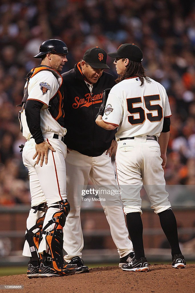 Tim Lincecum #55 of the San Francisco Giants talks to Dave Righetti #19 and Chris Stewart #37 during a game against the Arizona Diamondbacks at AT&T Park on September 3, 2011 in San Francisco, California.