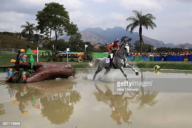 Tim Lips of the Netherlands riding Bayro clears a water jump during the Cross Country Eventing on Day 3 of the Rio 2016 Olympic Games at the Olympic...