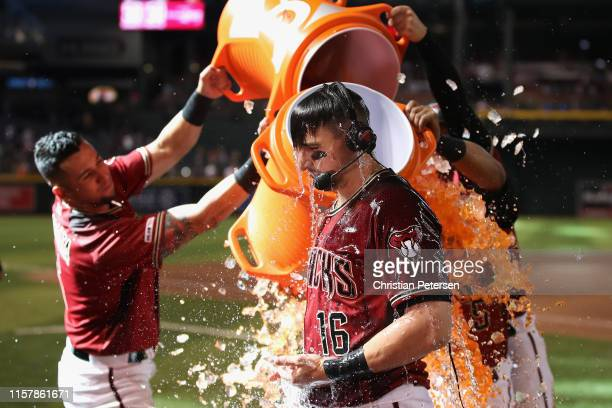 Tim Locastro of the Arizona Diamondbacks is dunked with gatorade from David Peralta and Eduardo Escobar after hitting a walkoff RBI single against...