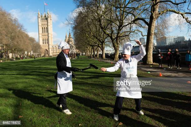 Tim Loughton MP and Steve Pound MP take part in the 20th Parliamentary Pancake Race on Shrove Tuesday also known as Pancake Day or Fat Tuesday in...