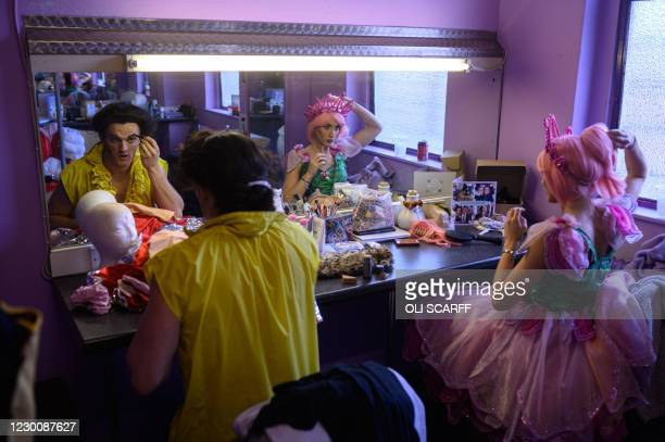 Tim Lucas, playing Gaston, and Jenna Sian O'Hara, playing Fairy Rose, in the Christmas pantomime 'Beauty and the Beast' prepare their make-up before...