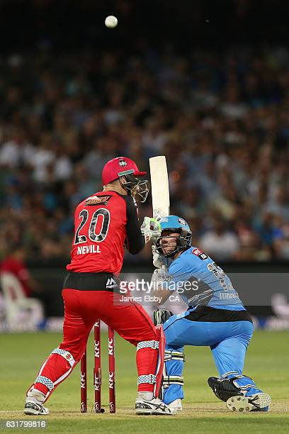 Tim Ludeman of Adelaide plays a shot over Peter Nevill of Melbourne during the Big Bash League match between the Adelaide Strikers and the Melbourne...