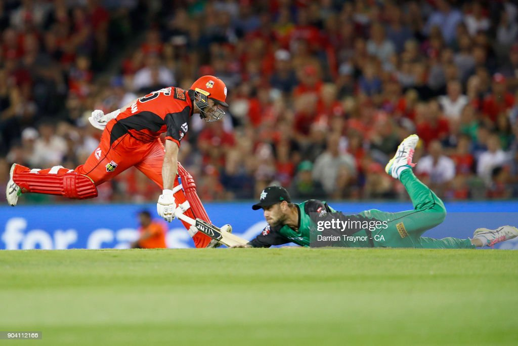 Tim Ludeman of the Melbourne Renegades runs as Glenn Maxwell of the Melbourne Stars attempts a run out during the Big Bash League match between the Melbourne Renegades and the Melbourne Stars at Etihad Stadium on January 12, 2018 in Melbourne, Australia.