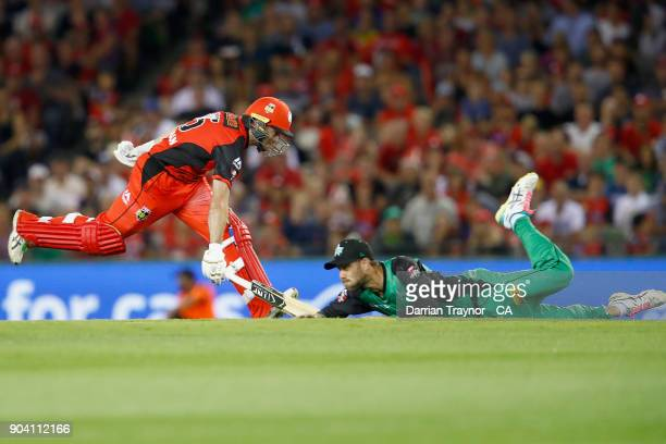 Tim Ludeman of the Melbourne Renegades runs as Glenn Maxwell of the Melbourne Stars attempts a run out during the Big Bash League match between the...