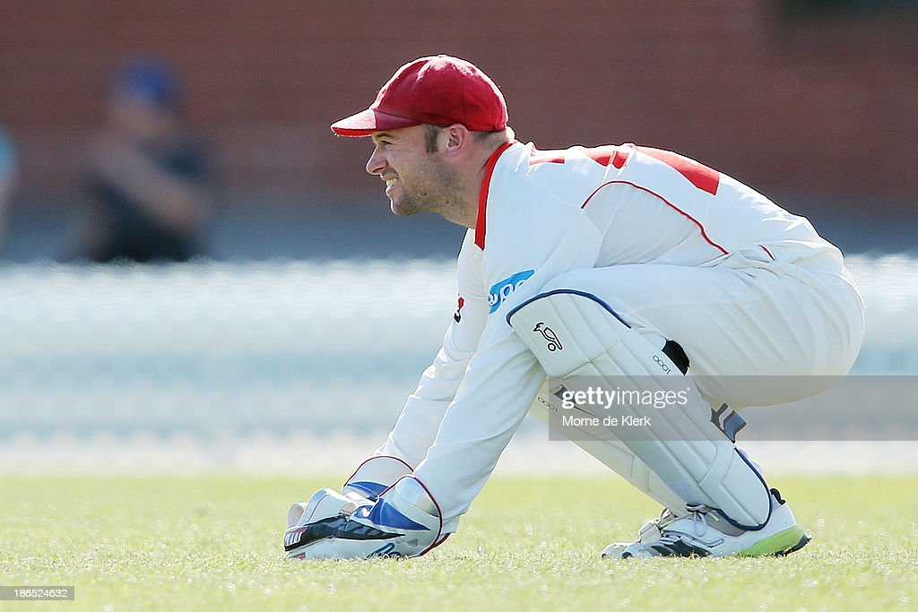 Tim Ludeman of the Redbacks keeps wicket during day three of the Sheffield Shield match between the South Australia Redbacks and the Queensland Bulls at Glenelg Oval on November 1, 2013 in Adelaide, Australia.