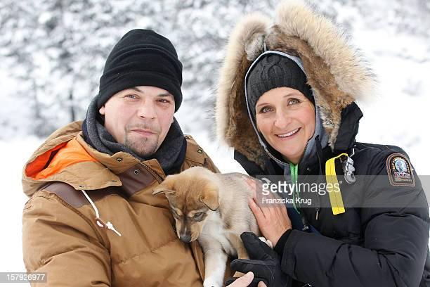 Tim Maelzer and Nina Heik attend the Tirol Cross Mountain Sledge Dog Race Training on December 07 in Kuehtai Austria