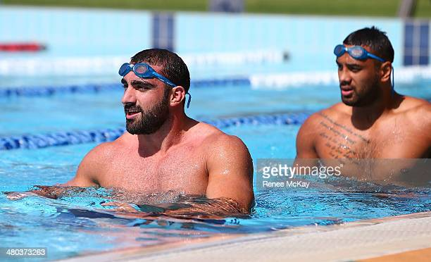 Tim Mannah and Kenny Edwards walk up the pool during a Parramatta Eels NRL recovery session at Pirtek Stadium on March 25 2014 in Sydney Australia