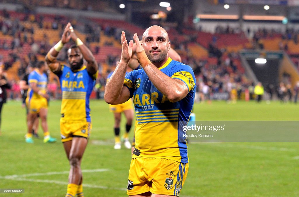 Tim Mannah of the Eels and team mates celebrate victory after the round 25 NRL match between the Brisbane Broncos and the Parramatta Eels at Suncorp Stadium on August 24, 2017 in Brisbane, Australia.