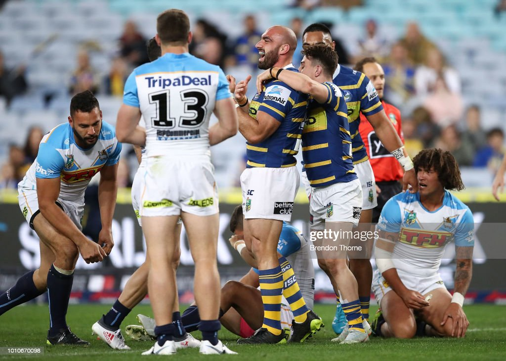 Tim Mannah of the Eels celebrates with team mates after scoring a try during the round 21 NRL match between the Parramatta Eels and the Gold Coast Titans at ANZ Stadium on August 4, 2018 in Sydney, Australia.