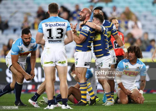 Tim Mannah of the Eels celebrates with team mates after scoring a try during the round 21 NRL match between the Parramatta Eels and the Gold Coast...