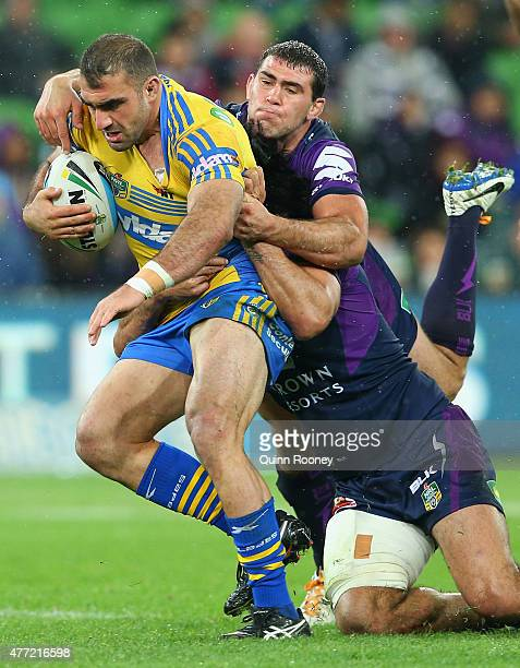 Tim Mannah of the Eels is tackled by Dale Finucane of the Storm during the round 14 NRL match between the Melbourne Storm and the Parramatta Eels at...