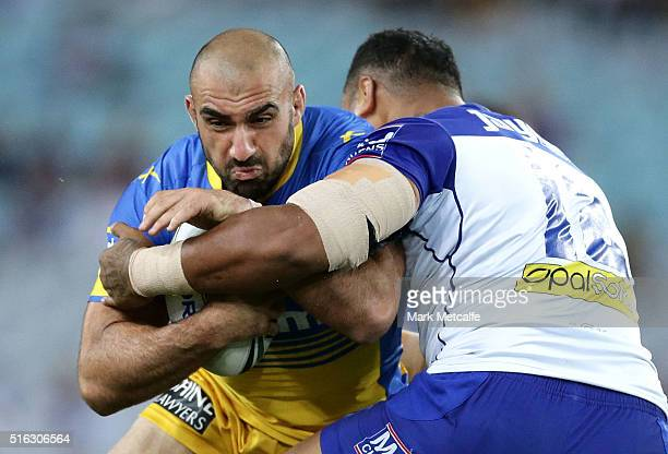 Tim Mannah of the Eels is tackled by Tony Williams of the Bulldogs during the round three NRL match between the Canterbury Bulldogs and the...