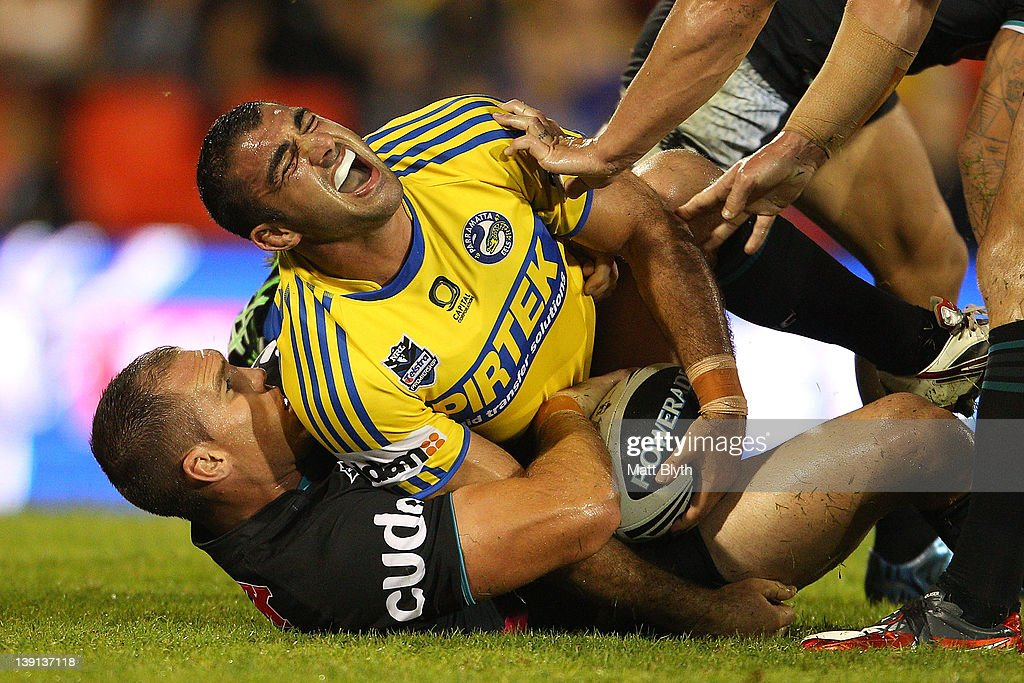 Tim Mannah of the Eels is tackled during the NRL trial match between the Penrith Panthers and the Parramatta Eels at Centrebet Stadium on February 17, 2012 in Sydney, Australia.