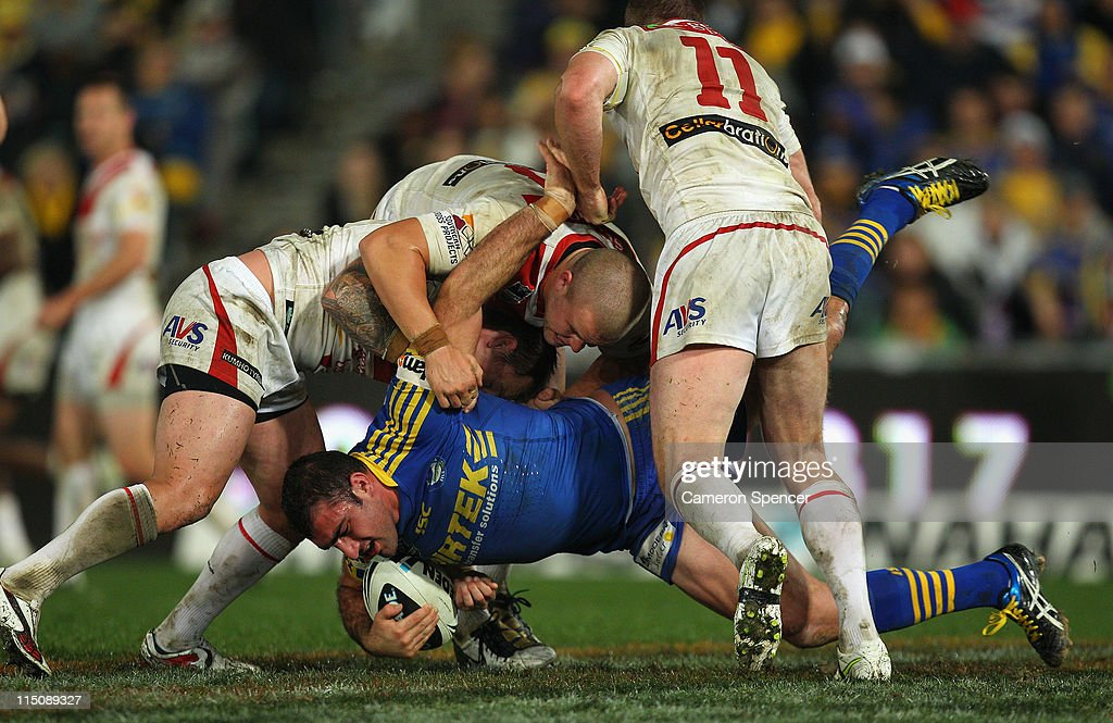 Tim Mannah of the Eels is tackled during the round 13 NRL match between the Parramatta Eels and the St George Illawarra Dragons at Parramatta Stadium on June 3, 2011 in Sydney, Australia.