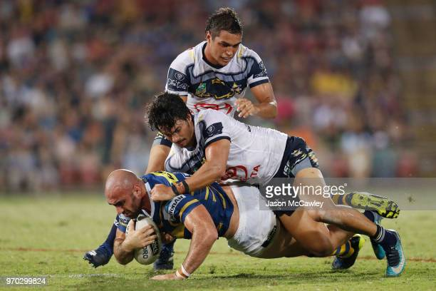 Tim Mannah of the Eels is tackled during the round 14 NRL match between the Parramatta Eels and the North Queensland Cowboys at TIO Stadium on June...