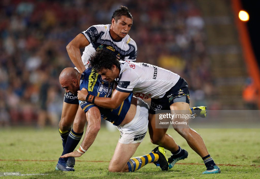 Tim Mannah of the Eels is tackled during the round 14 NRL match between the Parramatta Eels and the North Queensland Cowboys at TIO Stadium on June 9, 2018 in Darwin, Australia.