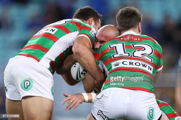 Tim Mannah of the Eels is tackled during the round 15 NRL match between the Parramatta Eels and the South Sydney Rabbitohs at ANZ Stadium on June 14...