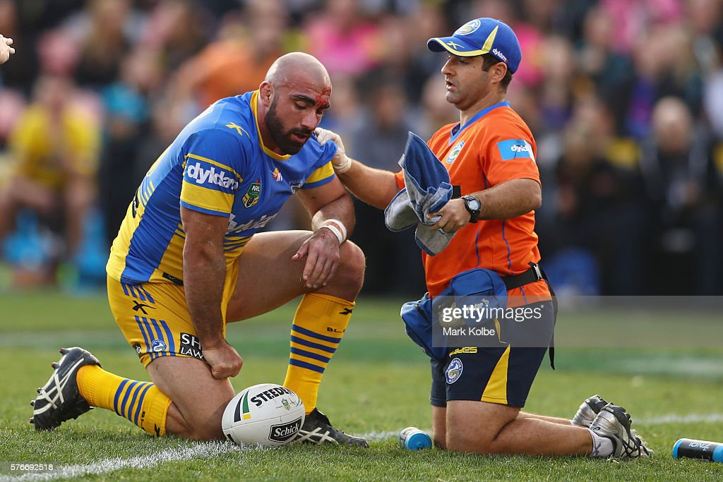 Tim Mannah of the Eels receives attention from the trainer during the round 19 NRL match between the Penrith Panthers and the Parramatta Eels at Pepper Stadium on July 17, 2016 in Sydney, Australia.
