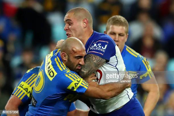 Tim Mannah of the Eels tackles David Klemmer of the Bulldogs during the round 17 NRL match between the Parramatta Eels and the Canterbury Bulldogs at...